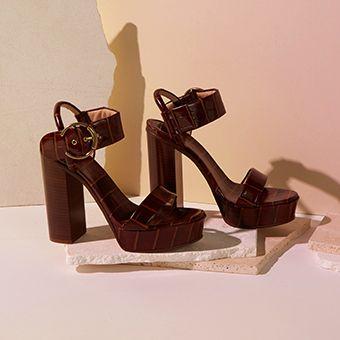 b5abfabfa83 Hero piece. Statement heeled sandals